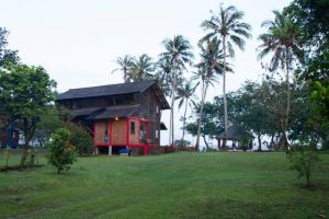Rumah Merah surrounded by vast green garden of Honje Ecolodge